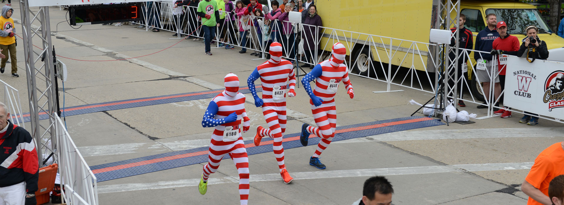 Start of the Race With 3 Runners Dressed in American Flag Spandex Costumes